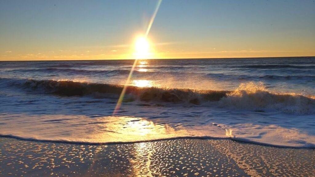 Sunrise over the ocean waves