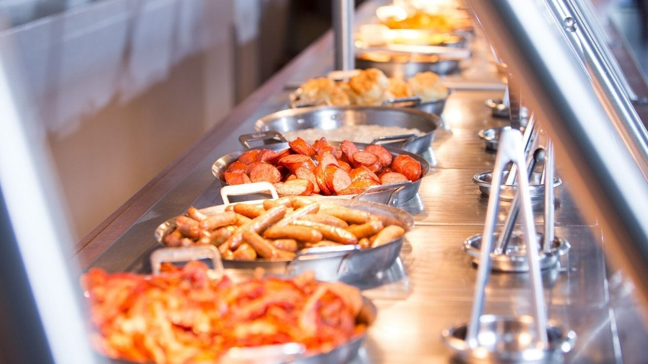 Breakfast buffet with bacon ., sausage, and eggs