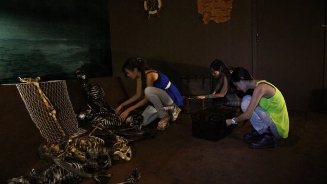 Girls doing puzzle at escape room