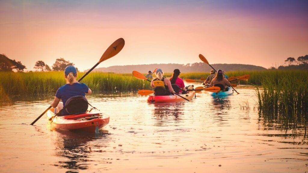 Family kayaking on the marsh