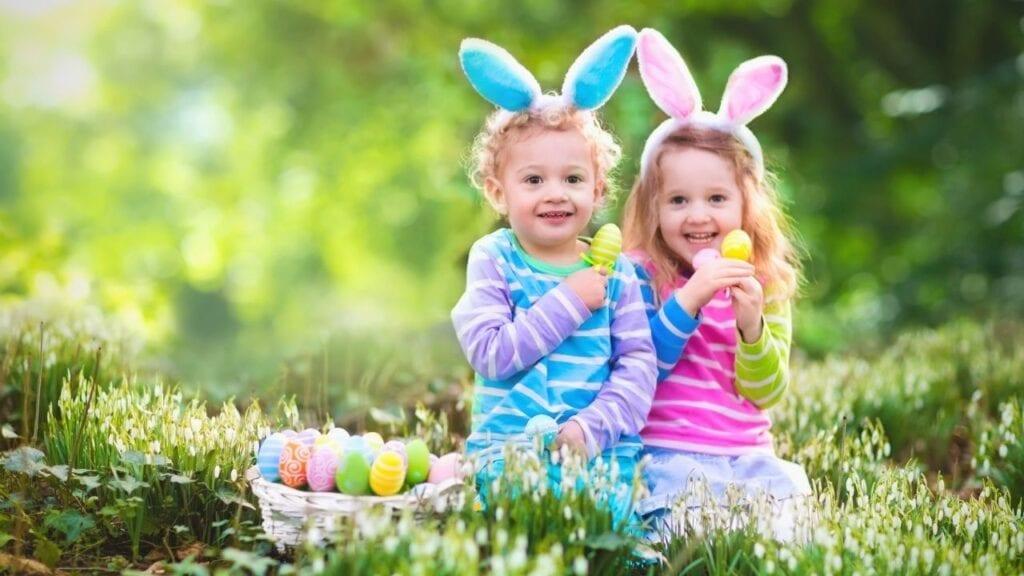 Little boy and girl holding Easter eggs